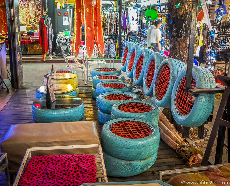 Cool chairs made from car wheels in a small bar inside the indoor night market in Chiang Mai