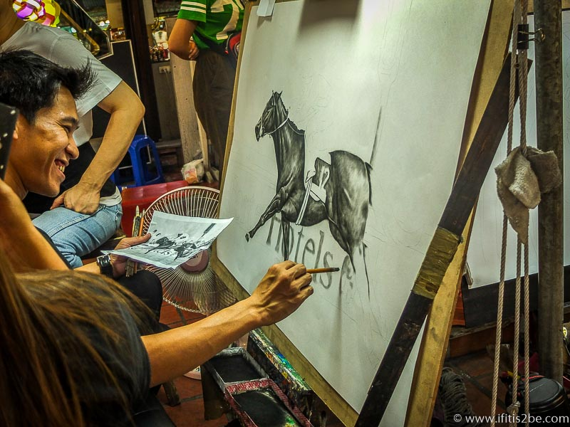 Artist Recreating images at the night market in Chiang Mai